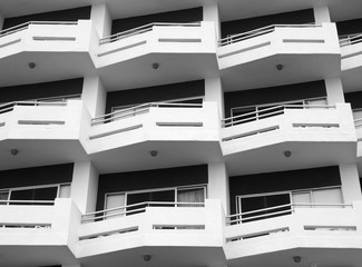 modern apartments with geometric white balconies with angular railings