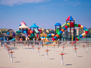 Wall Mural - Playground with colorful structures on the beach.