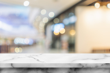 white marble table with interior in shopping mall.