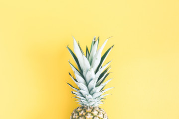 Pineapple on yellow background. Summer concept. Flat lay, top view