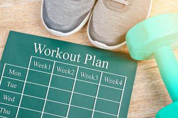 Workout plan on green board.
