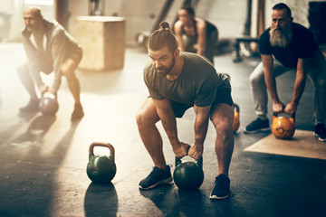 People working out together with dumbbells in a gym class