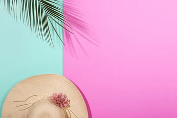 Colorful summer female fashion outfit flat-lay. Pink blue background, palm branches. Punchy Pastels. New Minimalism
