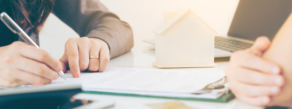 Client Signs Document to Buy House and Real Estate