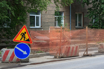 Road works city street. Road work and detour signs.
