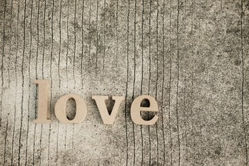 """Wooden letters word """"LOVE"""" on concrete floor.Love text in nature garden.Use for Valentine day concept background.Wooden alphabets & Words.Copy space."""