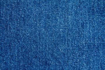 part of blue worn denim close-up, background