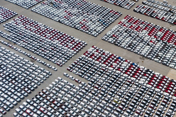 New cars from the car factory parked at the port waiting for export to the country as orderedNew cars from the car factory parked at the port waiting for export to the country as ordered