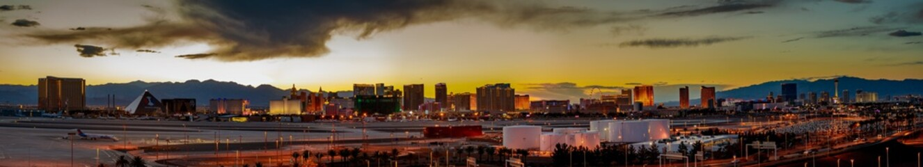 Skyline view at sunset of the famous Las Vegas Strip located in world class hotels and casinos, NV