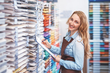 Smiling attractive girl in art store