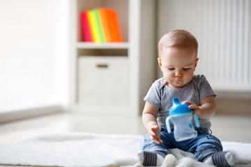 Boy holding his bottle