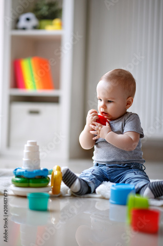 0596085f6 Cute little child holding his toy