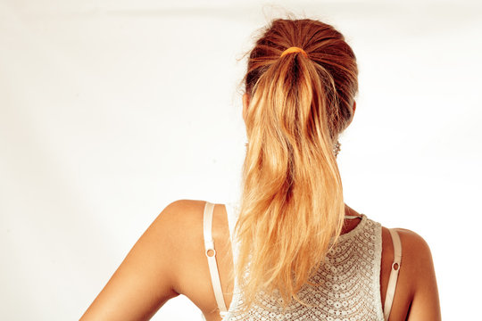 Portrait Of Beautiful Middle Age Blond Woman With Pony Tail Dyed Hair. Backside View