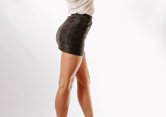 Side View Middle section of a woman in black mini skirt.