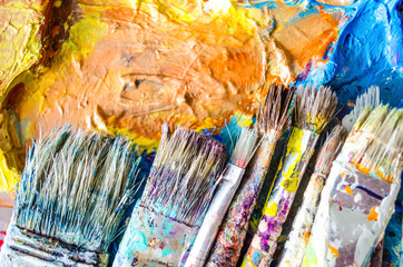 Artist paint brushes and palette