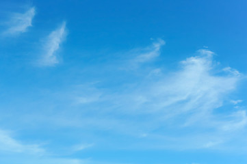 blue sky with white clouds, fluffy clouds on the blue sky
