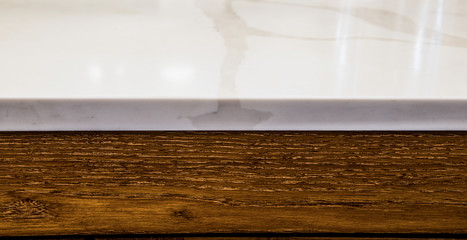 close up of marble and wood cabinet