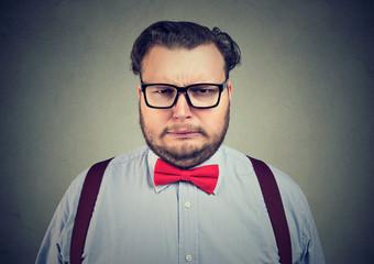 Grumpy obese man frowning at camera