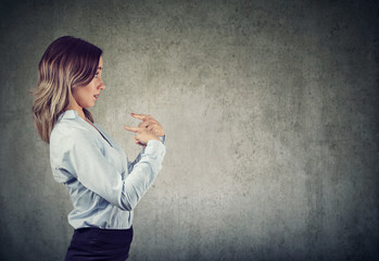 Surprised woman pointing fingers at herself being misunderstood