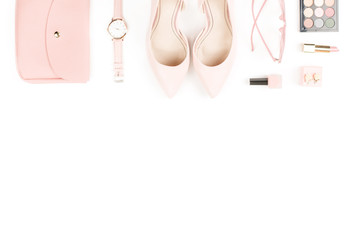 Fashion blogger workspace flat lay with pumps, cosmetics, purse, sunglasses.