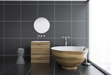 Black tile bathroom, wooden tub and sink, side