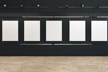 Row of blank posters on black mock up gallery
