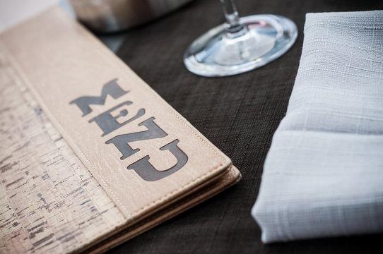 closeup of menu sign on table at restaurant