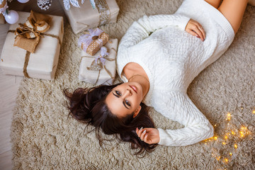 beautiful woman lying on the floor, the concept of the new year holiday