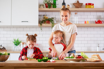 Picture of mother with daughter and son cooking at table