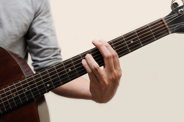 Guitar chords,Selective focus,Guitarist,The musicians are catching the guitar chords is A minor chord full bar on white background