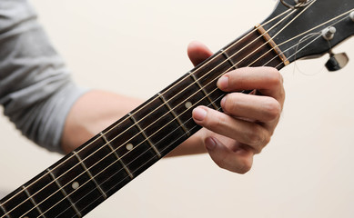 Selective focus,Guitarist,The musicians are catching the guitar chords is D chord on white background