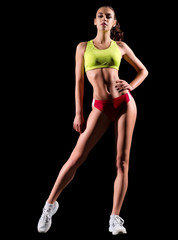 Sporty girl isolated on black