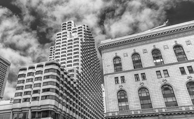 SAN FRANCISCO - AUGUST 5, 2017: Buildings of San Francisco against blue sky. The city attracts 20 million people annually.