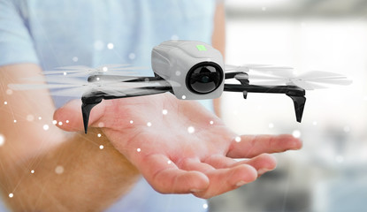 Businessman using modern drone 3D rendering