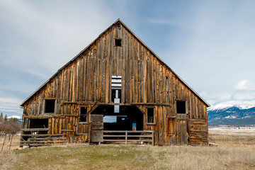 Close up of a large single Brown wooden barn on a country farm