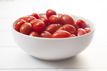 Grape Tomatoes in a White Bowl on a White Wood Table