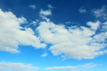 Beautiful natural blue sky and white fluffy clouds. Background. Landscape.