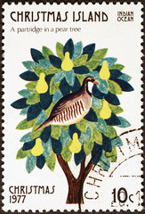 Twelve days of Christmas - a partridge in a pear tree on postage stamp of Christmas Island