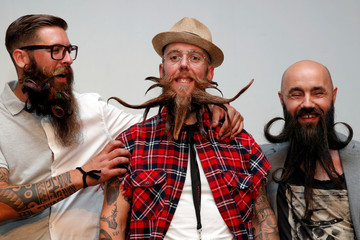 Competitors in the French 2018 beards championship, freestyle category, pose prior to the judging in Paris