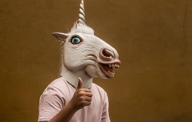 Unicorn funny plastic mask photograph