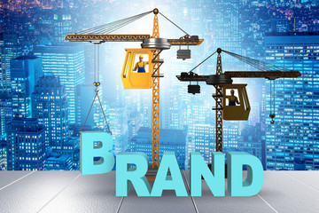 Crane lifting brand letters on commercial concept
