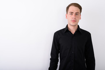 Young handsome businessman against white background