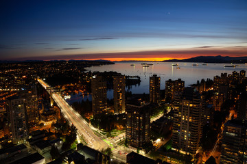 Beautiful aerial cityscape view during a vibrant sunset. Taken in Downtown Vancouver, British Columbia, Canada.