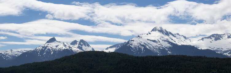 Panoramic view of the beautiful Canadian Mountain Landscape viewed from the Sea to Sky viewpoint. Taken between Squamish and Whistler, North of Vancouver, BC, Canada.