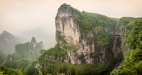 Panorama of the Tianmen Mountain Peak with a view of the cave Known as The Heaven's Gate surrounded by the green forest and mist at Zhangjiagie, Hunan Province, China, Asia