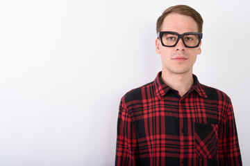 Young handsome man wearing eyeglasses against white background