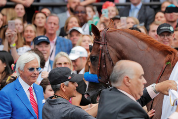 Horse trainer Bob Baffert (L) stands with Justify after winning the 150th running of the Belmont Stakes, the third leg of the Triple Crown of Thoroughbred Racing at Belmont Park in Elmont, New York