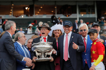 Owners Kenny Troutt gestures as Teo Ah Khing, of the China Horse Club is handed the Belmont Stakes trophy with trainer Bob Baffert after Justify won the 150th running of the Belmont Stakes, the third leg of the Triple Crown of Thoroughbred Racin