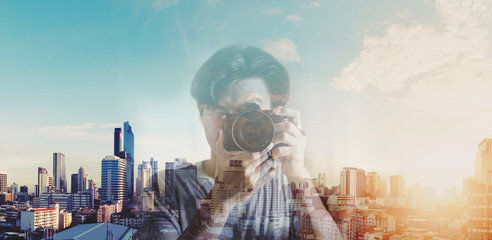 Double exposure, a man taking photography and city sunrise background