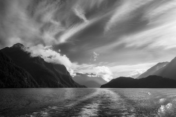 Dramatic clouds and alpine scenery at Lake Manapouri in black and white -New Zealand, South Island.